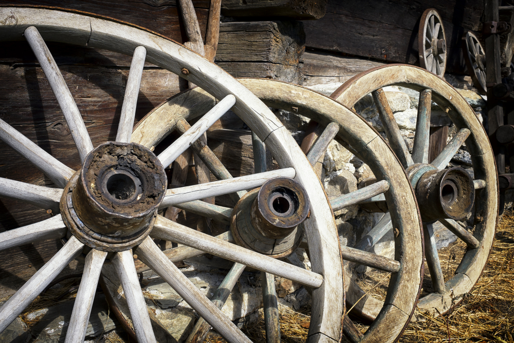Old wagon wheels with strakes.