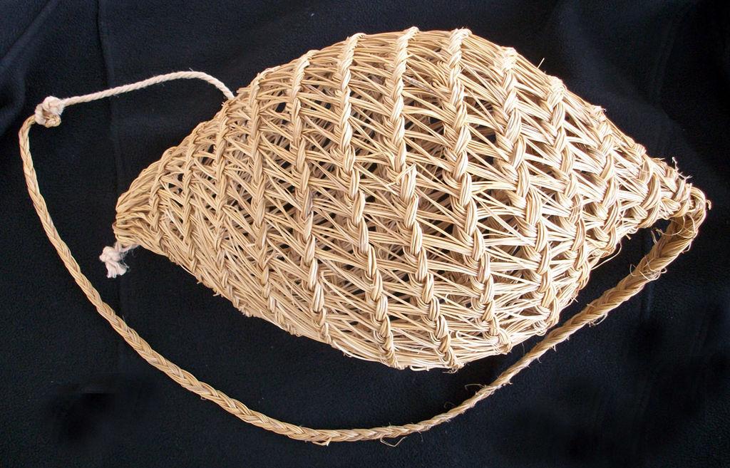 A snail basket woven from esparto grass.
